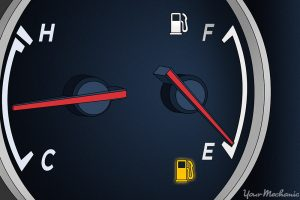 21528_How Far Can You Drive Your Vehicle on Empty - 1 A fuel gauge on empty with the low fuel warning light illuminated